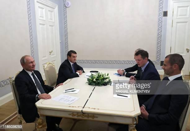 Russian President Vladimir Putin meets with UEFA president Aleksander Ceferin in Saint Petersburg on November 27, 2019.