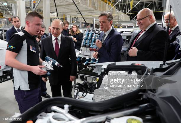 Russian President Vladimir Putin MercedesBenz Cars' member of the Divisional Board Marcus Schaefer German Economy Minister Peter Altmaier and Daimler...