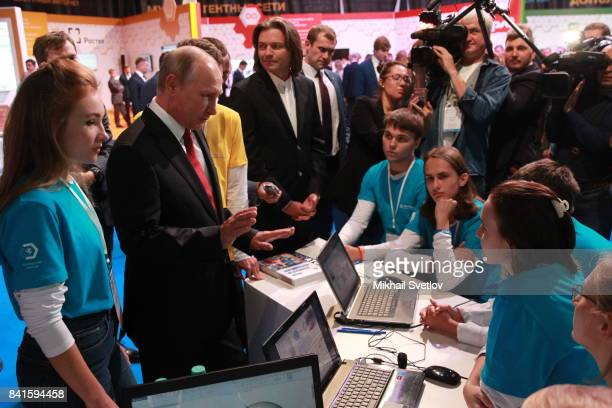 Russian President Vladimir Putin observes an exhibition prior to the AllRussia's Open Lesson in Yaroslavl 260 km north of Moscow Russia September2017...
