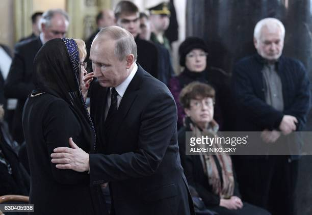 Russian President Vladimir Putin offers his condolences to Marina Davydova Karlova the widow of slain Russian Ambassador to Turkey Andrei Karlov...