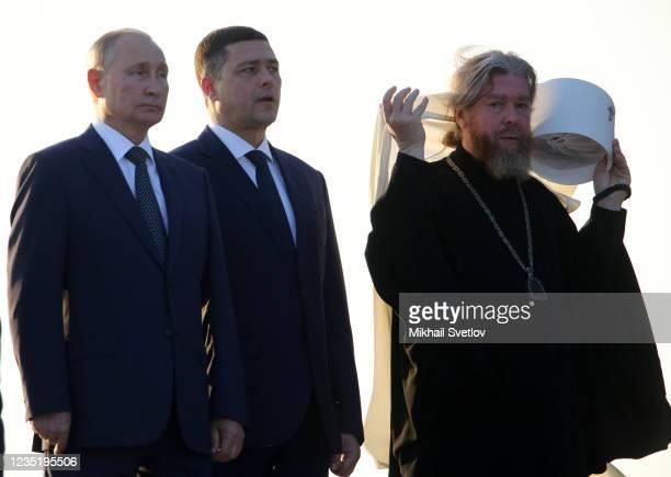 Russian President Vladimir Putin , Orthodox Church Bishop of Kaliningrad Tikhon Shevkunov and Governor of Pskov Mikhail Vedernikov attend the opening...