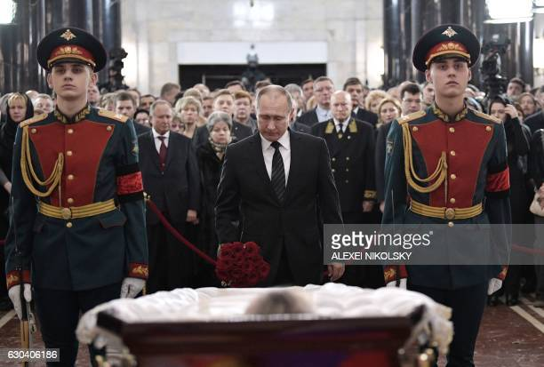 Russian President Vladimir Putin pays his respects to slain Russian Ambassador to Turkey Andrei Karlov during the funeral ceremony at the Russian...