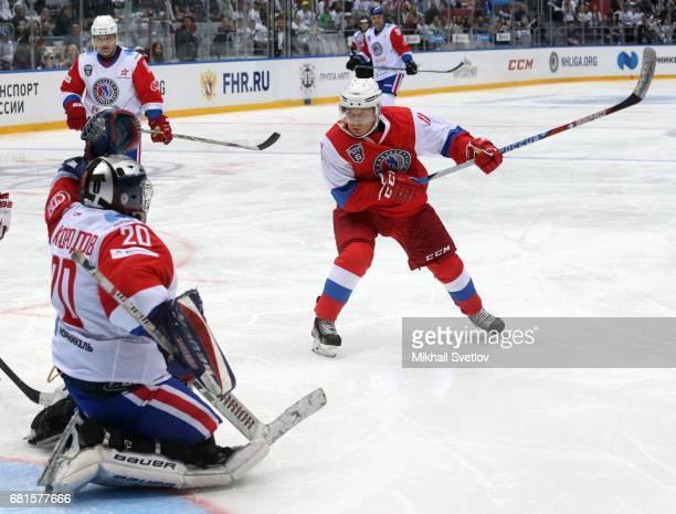 Russian President Vladimir Putin plays a gala match of the Night Hockey League teams at the Bolshoy ice arena at Black Sea resort of Sochi Russia...