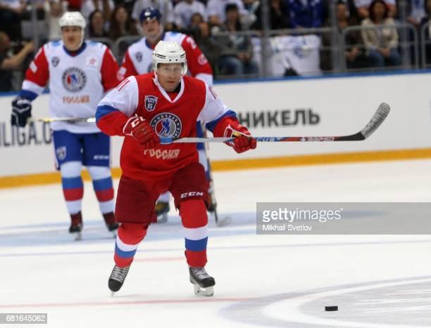 Russian President Vladimir Putin plays ice hockey during the gala match of the Night Hockey League teams at the Bolshoy ice arena at Black Sea resort...