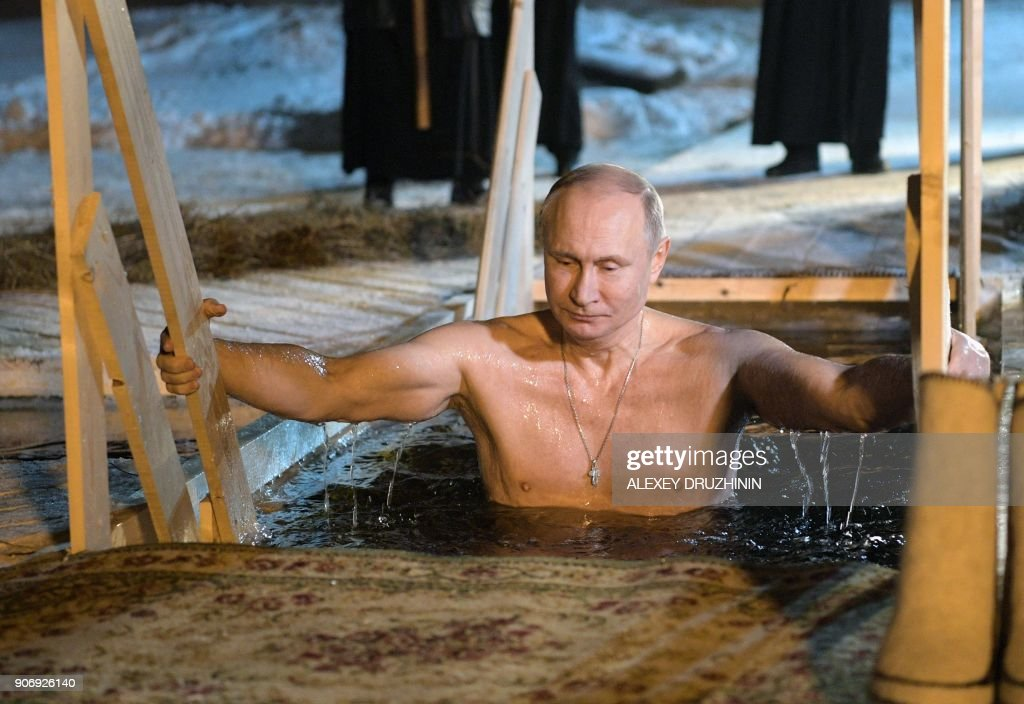 Putin Takes Epiphany's Icy Plunge With Pilgrims