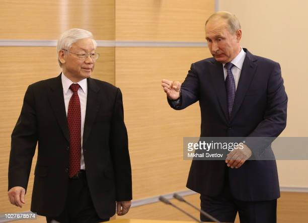 SOCHI RUSSIA SEPTEMBER6 Russian President Vladimir Putin points to Vietnamese Communist Party General Secretary Nguyen Phu Trong during their meeting...
