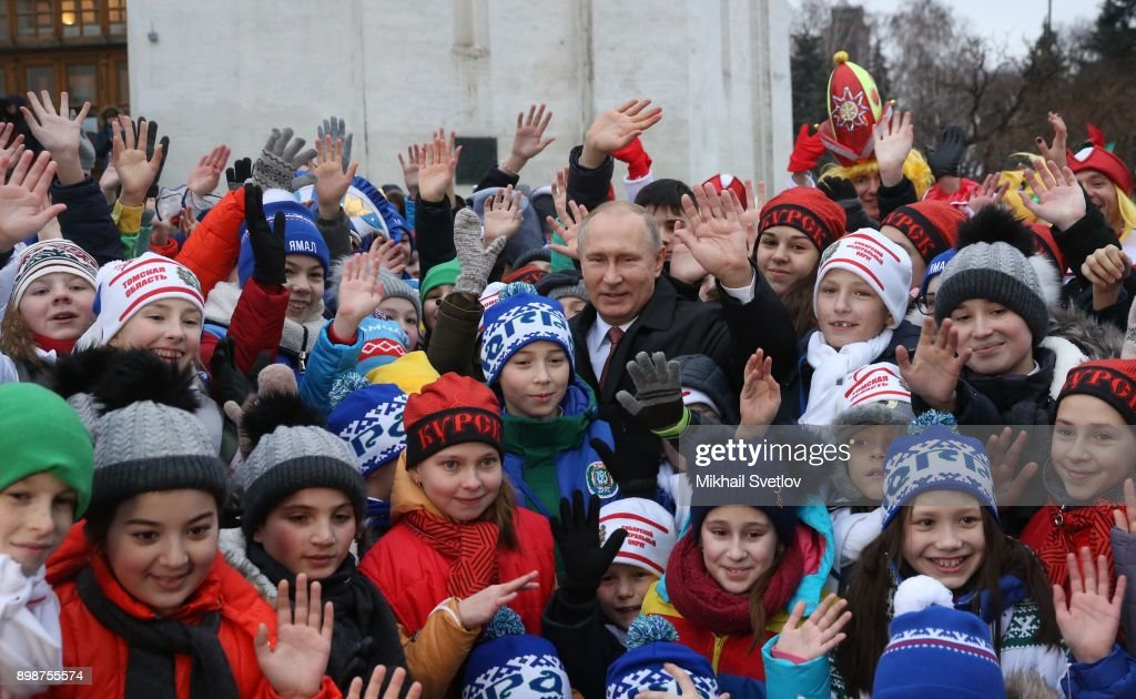 Russian President Vladimir Putin (C) pose for a photo with kids at the on December 26, 2017 in the Cathedral Square of Moscow's Kremlin, Russia. Vladimir Putin met children from some regions after they visited the New Year show at the State Kremlin Palace. Photo by Mikhail Svetlov/Getty Images)