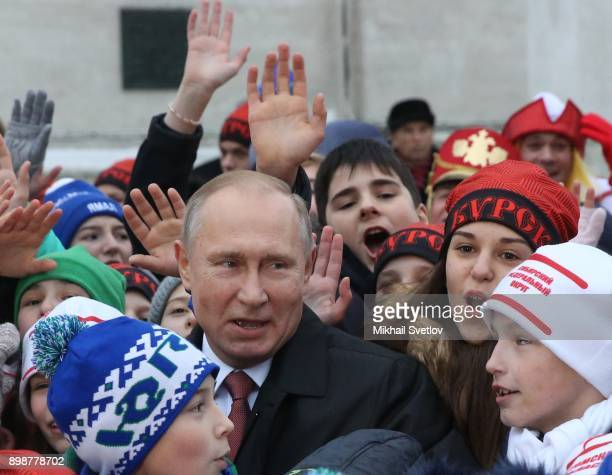 Russian President Vladimir Putin pose for a photo with kids at the Cathedral Square of Moscow's Kremlin Russia December2017 Vladimir Putin met...