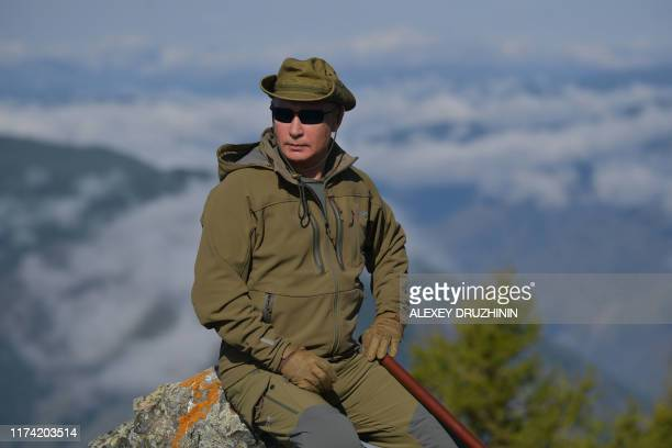 Russian President Vladimir Putin poses during his leisure time in the Siberian Taiga area on October 6, 2019.