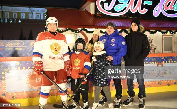 """Russian President Vladimir Putin poses with 9-year-old Dmitry Aschepkov, living in Chelyabinsk city after playing ice hockey with him within """"Dream..."""