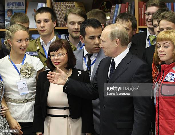 Russian President Vladimir Putin poses with students of Arkhangelsk University June 9 2014 in Arkhangelsk Russia Putin is on a oneday trip to...