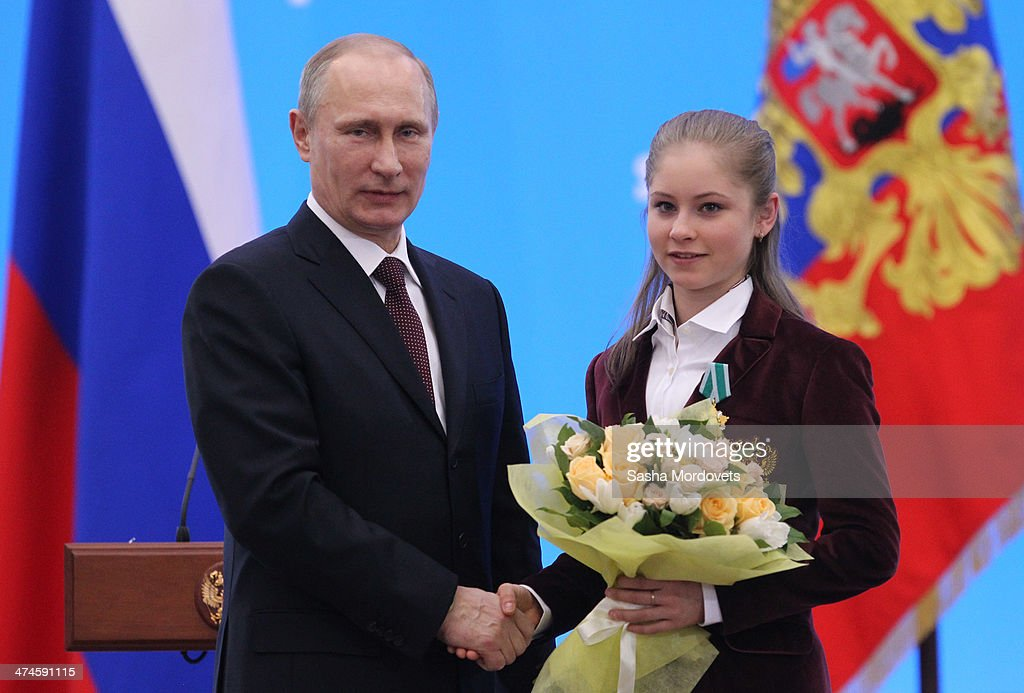 Russian President Vladimir Putin presents Olympic gold medalist in figure skating Yulia Lipnitskaya (R) with an award during an awards ceremony for Russian Olympic athletes on February 24, 2014 in Sochi, Russia. Russian President Vladimir Putin presented awards to members of the Russian Olympic team a day after the closing ceremony of the 2014 Winter Olympics, in which Russia topped the medals table with 13 gold, 11 silver and 9 bronze medals.