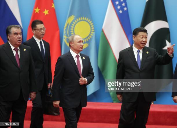 Russian President Vladimir Putin President of the Peoples Republic of China Xi Jinping and President of the Republic of Tajikistan Emomali Rahmon...