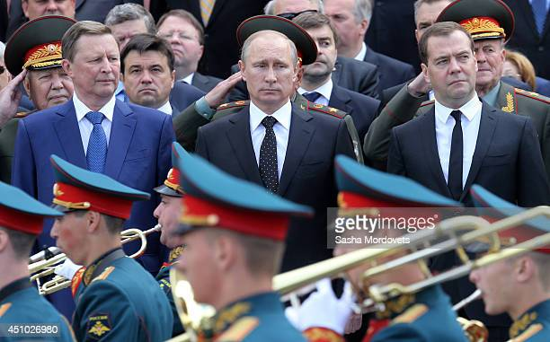 Russian President Vladimir Putin Prime Minister Dmitry Medvedev and Chief of the Staff Sergei Ivanov attend a wreath laying ceremony at the Tomb of...