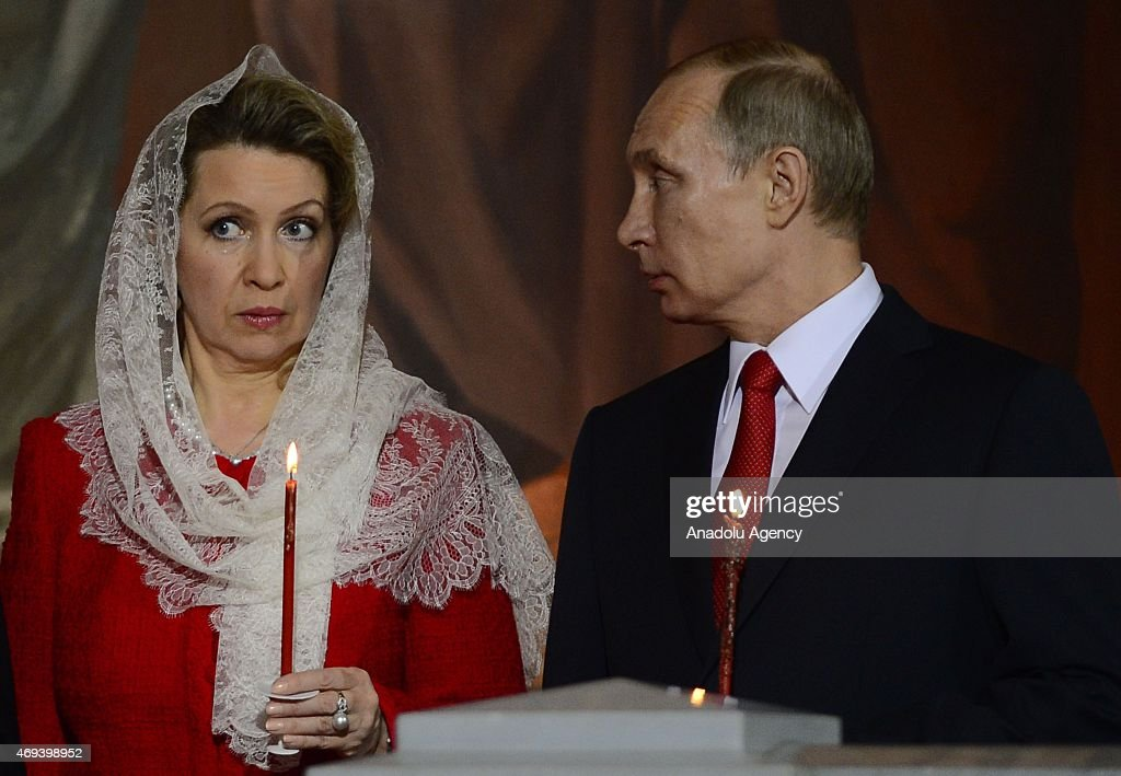 Russian President Vladimir Putin (R), Prime Minister Dmitry Medvedev (not seen) and his wife Svetlana (L) attend the Easter service in Christ the Savior Cathedral in Moscow, Russia on April 12, 2015. Orthodox Christian believers mark the Holy Week of Easter in celebration of the crucifixion and resurrection of Jesus Christ.