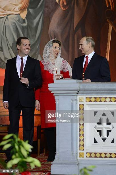 Russian President Vladimir Putin Prime Minister Dmitry Medvedev and his wife Svetlana attend the Easter service in Christ the Savior Cathedral in...