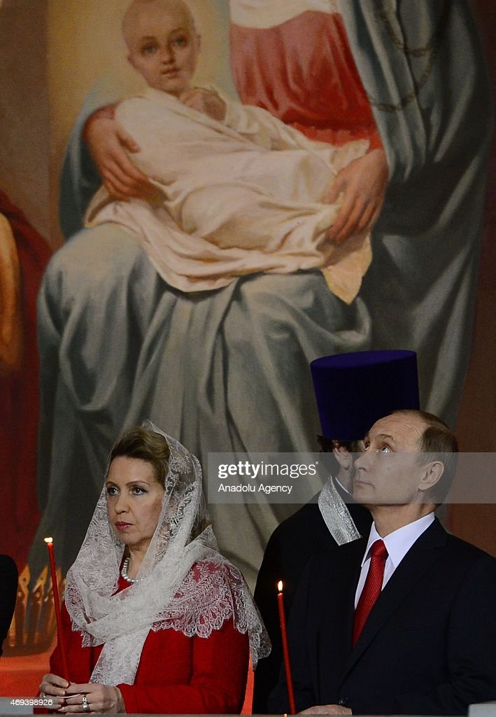 Russian President Vladimir Putin (R), Prime Minister Dmitry Medvedev (not seen), his wife Svetlana (L2) attend the Easter service in Christ the Savior Cathedral in Moscow, Russia on April 12, 2015. Orthodox Christian believers mark the Holy Week of Easter in celebration of the crucifixion and resurrection of Jesus Christ.