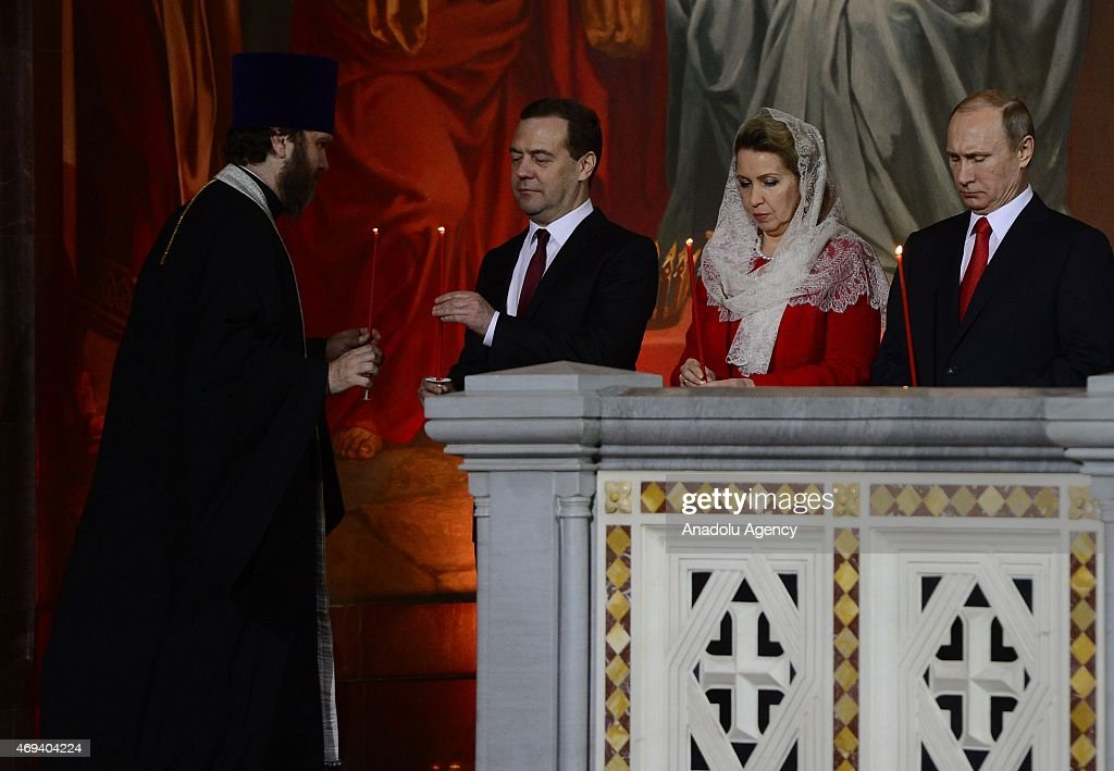 Russian President Vladimir Putin (R), Prime Minister Dmitry Medvedev (L2), his wife Svetlana (L3) attend the Easter service in Christ the Savior Cathedral in Moscow, Russia on April 12, 2015. Orthodox Christian believers mark the Holy Week of Easter in celebration of the crucifixion and resurrection of Jesus Christ.