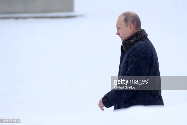 Russian President Vladimir Putin puts flowers to the monuments at Piskaryovskoye cemetery in Saint Peterburg January2018 The Red Army broke the...