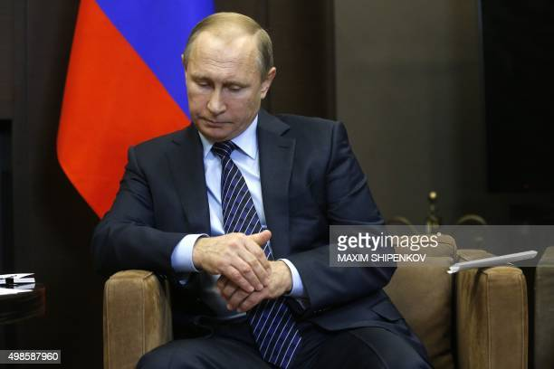 Russian President Vladimir Putin reacts during a meeting with Jordanian King Abdullah II at the Bocharov Ruchei state residence in Sochi on November...