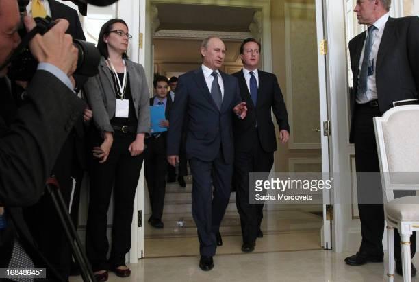 Russian President Vladimir Putin receives Britain's Prime Minister David Cameron at his Bocharov Rruchey residence on May 10 2013 in Sochi Russia...