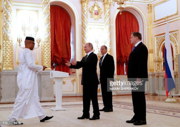 Russian President Vladimir Putin receives credentials from Sierra Leone ambassador to Russia Mohamed Yongawo , as Russian Foreign Minister Sergei...