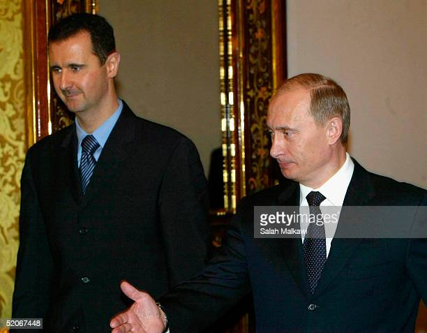 Russian President Vladimir Putin receives Syrian President Bashar alAssad during their meeting in Moscow's Kremlin January 25 2005 Russia and Syria...
