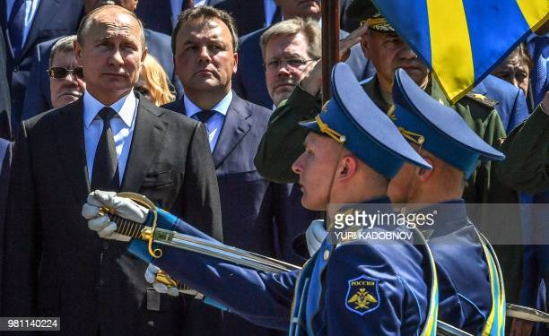 Russian President Vladimir Putin reviews troops parading during a ceremony marking the anniversary of the Nazi German invasion in 1941, at the...