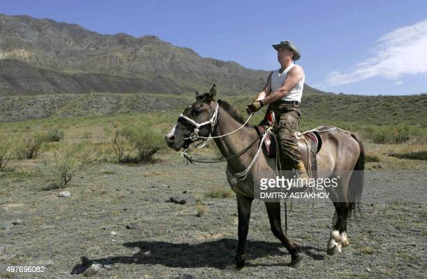 Russian President Vladimir Putin rides a horse near the foothills of the Western Sayan Mountains in the Republic of Tuva, 15 August 2007. Putin is...