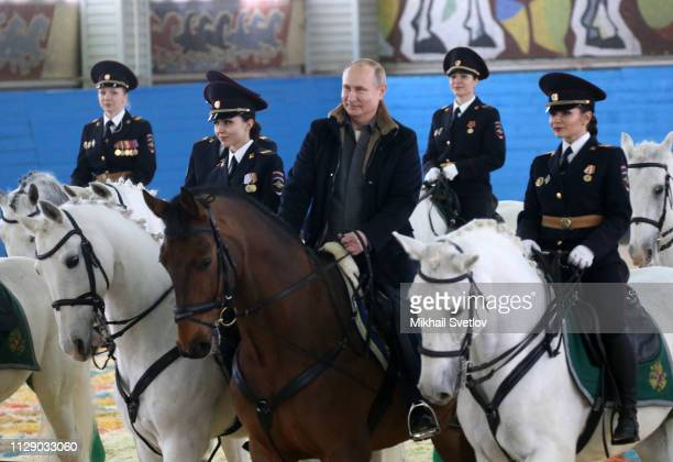 Russian President Vladimir Putin rides a horse while visiting the mounted police department on March 7, 2019 in in Moscow, Russia. Putin...