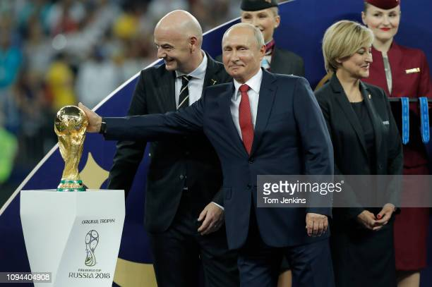 Russian President Vladimir Putin rubs the top of the trophy after the France v Croatia FIFA World Cup 2018 final at the Luzhniki Stadium on July 15th...