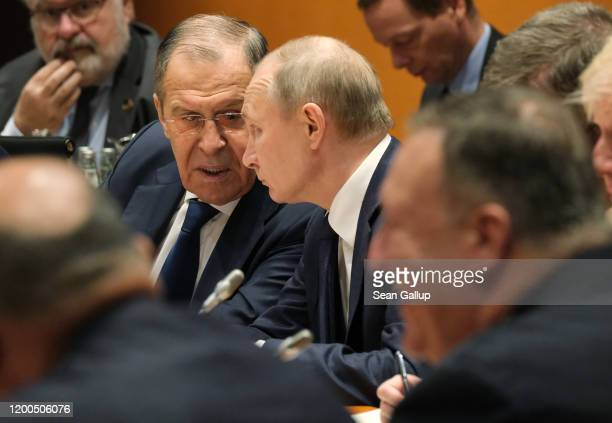 Russian President Vladimir Putin , Russian Foreign Minister Sergey Lavrov and U.S. Secretary of State Mike Pompeo attend the main session at an...