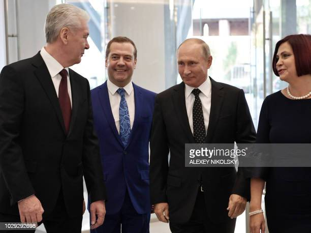 Russian President Vladimir Putin Russian Prime minister Dmitry Medvedev and Moscow's mayor Sergei Sobyanin arrive to the opening ceremony of Zaryadye...