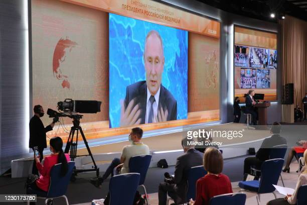 Russian President Vladimir Putin seen speaking on the screen during his annual press conference, on December 17 in Moscow, Russia. This year about...