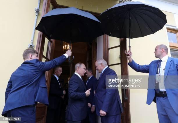 Russian President Vladimir Putin sees Belarus' President Alexander Lukashenko off following their talks in Saint Petersburg on July 18, 2019.