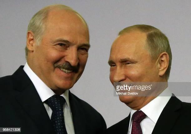 Russian President Vladimir Putin shakes hands with Belarussian President Alexander Lukashenko during their bilateral meeting prior to the Eurasian...