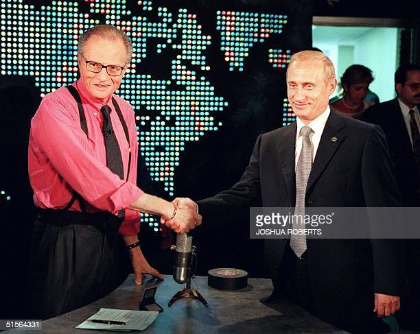 Russian President Vladimir Putin shakes hands with CNN interviewer Larry King before the start his interview in New York 08 September, 2000. Putin is...