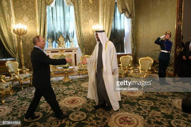 Russian President Vladimir Putin shakes hands with Crown Prince of Abu Dhabi Mohammed bin Zayed Al Nahyan during the meeting at the Grand Kremlin...