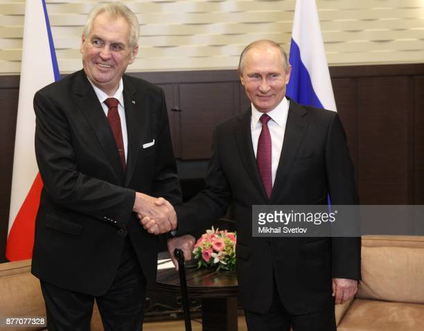 Russian President Vladimir Putin shakes hands with Czech President Milos Zeman during their talks at Black Sea resort state residence of Bocharov...