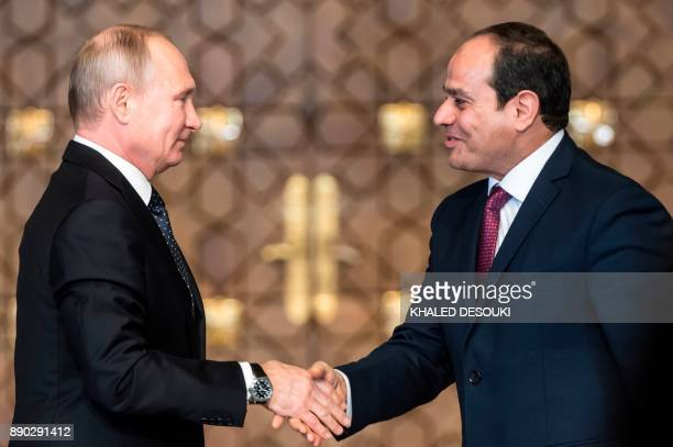 Russian President Vladimir Putin shakes hands with Egyptian counterpart Abdel Fattah alSisi after giving a press conference following their talks at...