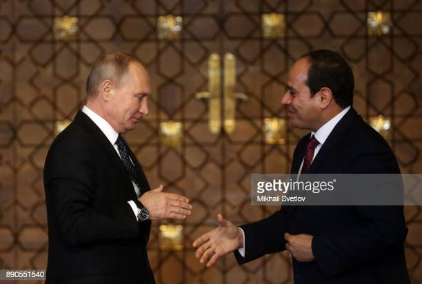 Russian President Vladimir Putin shakes hands with Egyptian President Abdel Fattah elSisi during their meeting on December 11 2017 in Cairo Egypt...