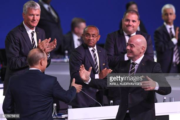 Russian President Vladimir Putin shakes hands with FIFA president Gianni Infantino during the 68th FIFA Congress at the Expocentre in Moscow on June...