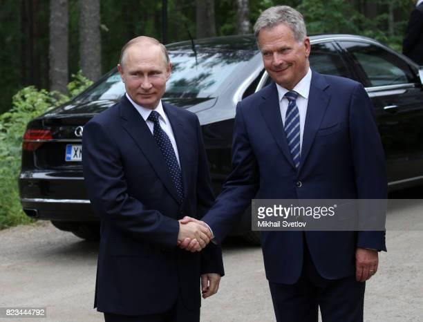 Russian President Vladimir Putin shakes hands with Finland's President Sauli Niinisto during their meeting on July 27 2017 in Punkaharju Finland...