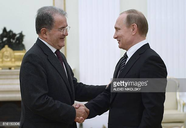 Russian President Vladimir Putin shakes hands with former Italian prime minister Romano Prodi during a meeting at the Kremlin in Moscow on March 17...