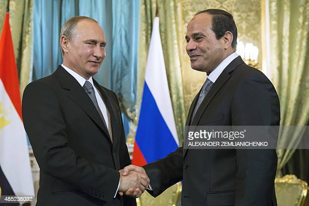 Russian President Vladimir Putin shakes hands with his Egyptian counterpart Abdel Fattah alSisi during a meeting at the Kremlin in Moscow on August...