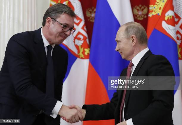Russian President Vladimir Putin shakes hands with his Serbian counterpart Aleksandar Vucic as they address the media following a meeting at the...