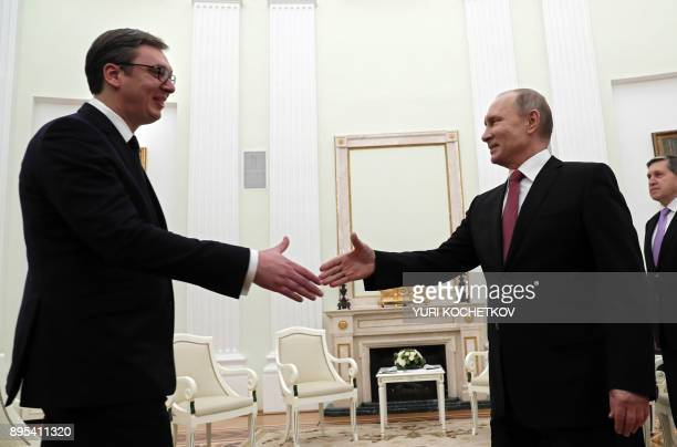 Russian President Vladimir Putin shakes hands with his Serbian counterpart Aleksandar Vucic during their meeting at the Kremlin in Moscow on December...