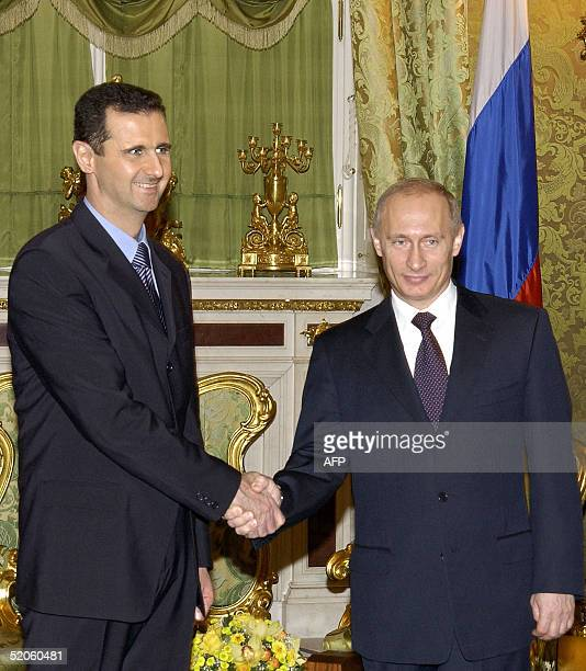 Russian President Vladimir Putin shakes hands with his Syrian counterpart Bashar alAssad during their meeting in Moscow 25 January 2005 The Syrian...