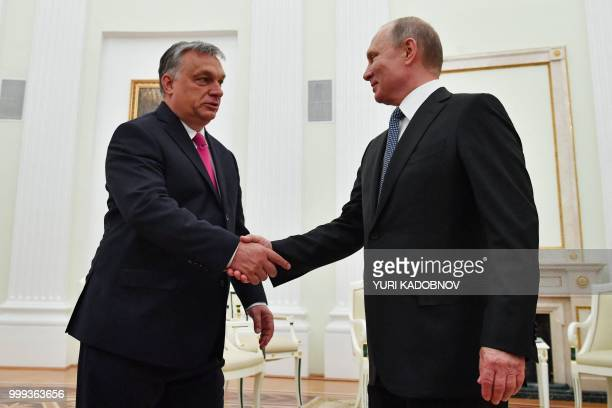 Russian President Vladimir Putin shakes hands with Hungary's Prime Minister Viktor Orban during their meeting at the Kremlin in Moscow on July 15 2018