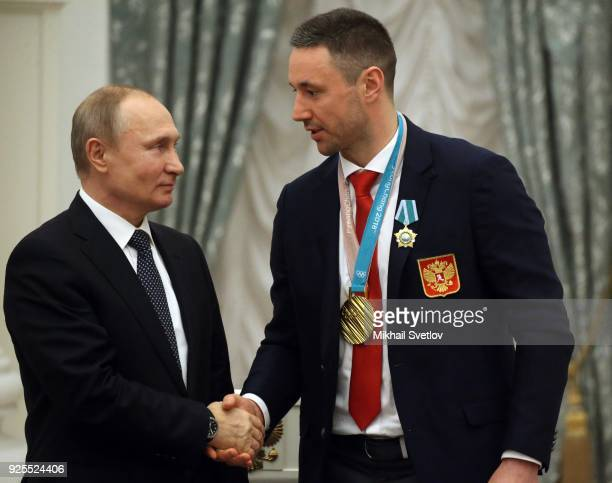 Russian President Vladimir Putin shakes hands with ice hockey player Ilya Kovalchuk during his meeting with athlets from Russia who took part in the...